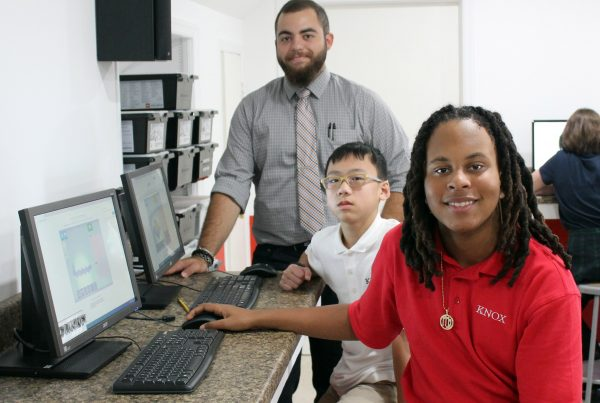Image of STEM Teacher Angelo Mauro with two students