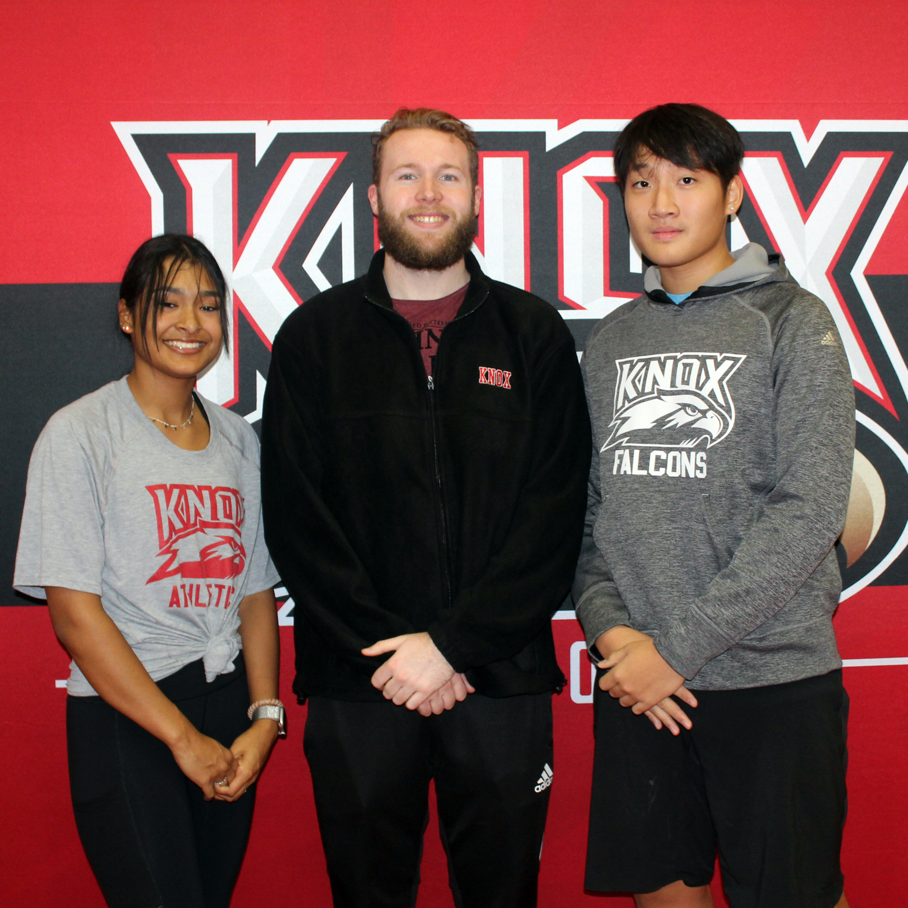 Image of Knox rowing coach and two student-athletes